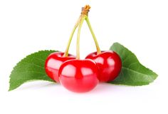 Sweet juicy cherry with green leaf Royalty Free Stock Images