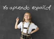 Sweet junior blond schoolgirl smiling happy  in children learning spanish language and education concept Stock Photo