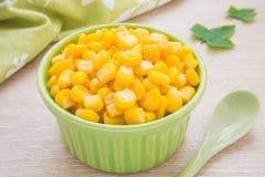 Sweet kernel corn in green bowl Royalty Free Stock Image