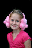 Sweet kid. A white caucasian child with a happy expression on her face wearing ear muffs Stock Photo