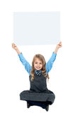 Sweet kid holding blank ad board above her head Stock Images
