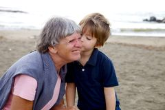Sweet kid kissing with love grandmother Stock Images