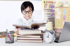 Sweet kindergarten student reading books Royalty Free Stock Image