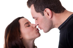 Sweet kiss. A sweet kiss between a couple isolated on a white background Royalty Free Stock Images