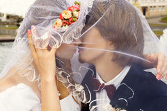 Sweet kiss. Bride and groom at the wedding Royalty Free Stock Images