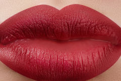 Sweet kiss. Close-up of woman's lips with fashion red make-up. Beautiful female mouth, full lips with perfect makeup Stock Photo