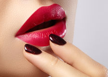 Sweet kiss. Close-up of woman's lips with fashion red make-up. Beautiful female mouth, full lips with perfect makeup Royalty Free Stock Image