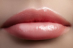 Sweet kiss. Close-up of woman's lips with fashion red make-up. Beautiful female mouth, full lips with perfect makeup Royalty Free Stock Photos