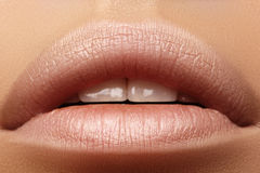 Sweet kiss. Perfect natural lip makeup. Close up macro photo with beautiful female mouth. Plump full lips Stock Photo