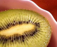 Sweet kiwi ready to eat. Kiwi cut in halves in the bowl ready to eat Stock Image