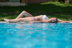 Sweet lady at the hotal pool Stock Photos