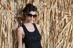 Sweet lady with slim body wear sleeveless and sunglasses Stock Photo