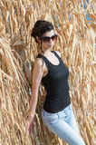 Sweet lady with slim body wear sleeveless and sunglasses Royalty Free Stock Photo