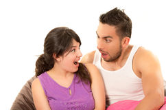 Sweet latin couple looking at each other surprised Royalty Free Stock Images