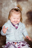 Sweet laughing  little girl with blond hair and closed eyes Royalty Free Stock Image