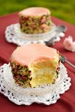 Sweet layered cake with cream and icing Royalty Free Stock Photography