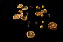 Sweet lemon and cape gooseberry on black background Stock Photos