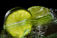 Sweet lime. On a mirrow with water Royalty Free Stock Images
