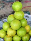 Sweet Limes for sale in market. Sweet Limes or Mosambi for sale in Fruit market of Sangli, Maharashtra, India Stock Photography