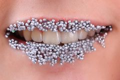 Sweet lips in the silver sugar balls royalty free stock photo
