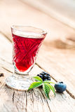 Sweet liqueur made of berry fruits and alcohol Stock Photo