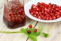 Sweet liqueur from wild strawberries Stock Photo