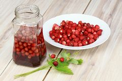 Sweet liqueur from wild strawberries Stock Photography