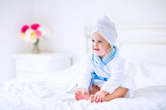 Sweet litlte girl in a bathrobe and towel Royalty Free Stock Photo