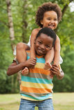 Sweet little african child. African brother and sister having fun in nature royalty free stock image