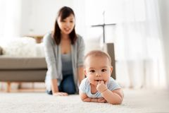 Sweet little asian baby boy with mother at home stock photography