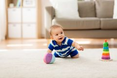 Sweet little asian baby boy with toys at home royalty free stock photo