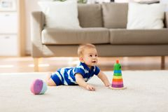Sweet little asian baby boy with toys at home royalty free stock image