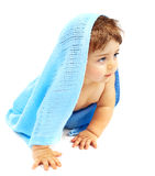 Sweet little baby boy covered blue towel Royalty Free Stock Photo