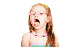 Sweet little baby girl eating bread isolated white Royalty Free Stock Photos