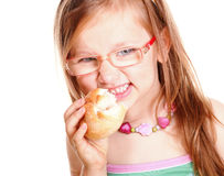 Sweet little baby girl eating bread  white Royalty Free Stock Images