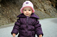 Sweet little baby girl with knitted hat. Sweet little baby girl with pink knitted hat Stock Photography