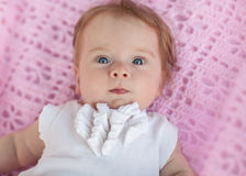 Sweet little baby girl lying on her back. Royalty Free Stock Photo