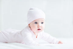 Sweet little baby girl lying on her tummy and knitted hat Stock Photography