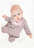 Sweet little baby girl in striped costume Royalty Free Stock Photos
