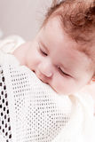 Sweet little baby infant toddler on blanket in basket Royalty Free Stock Image