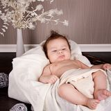 Sweet little baby infant toddler on blanket in basket Stock Photo