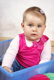 Sweet little baby sitting in the box Royalty Free Stock Photography