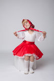 Sweet little ballerina posing in folk costume Royalty Free Stock Image