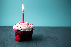 Sweet little birthday cake with candles Royalty Free Stock Photography