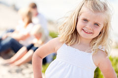 Sweet Little Blonde Girl Having Fun At the Beach Stock Images