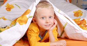 Sweet little boy in bed Royalty Free Stock Photography