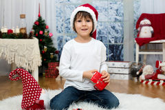 Sweet little boy, breaking his piggy bank to buy present for mom Stock Photo
