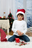 Sweet little boy, breaking his piggy bank to buy present for mom Stock Photography