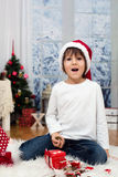 Sweet little boy, breaking his piggy bank to buy present for mom Stock Image