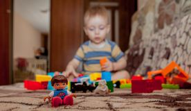 Sweet little boy building tower from cubes at home stock photography